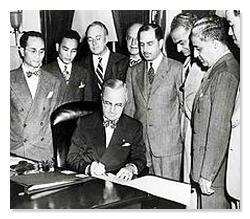 Truman signs the Luce-Celler Act of 1946